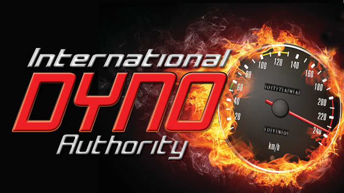 International dyno authority logo. A speedometer surrounded by flames